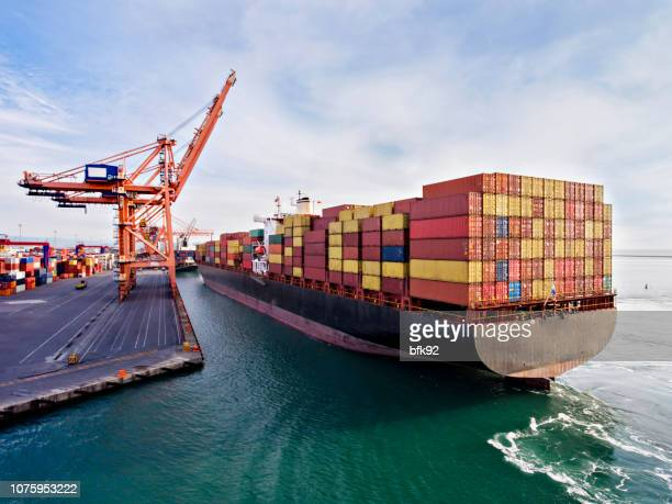 aerial view of cargo ship in transit. - commercial dock stock pictures, royalty-free photos & images
