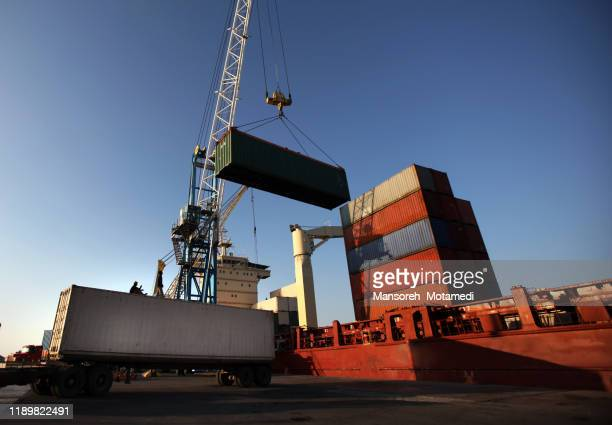 aerial view of cargo ship in transit - human settlement stock pictures, royalty-free photos & images