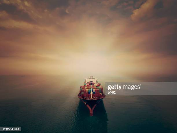 aerial view of cargo ship in transit. - harbour stock pictures, royalty-free photos & images