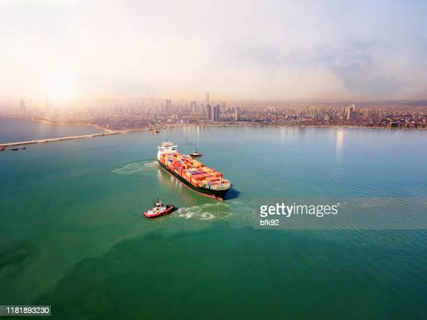 aerial view of cargo ship leaving the port. - istanbul stock pictures, royalty-free photos & images