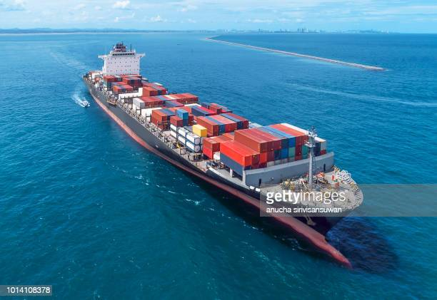 aerial view of cargo ship runing on sea close warehouse harbor at thailand . - schiff stock-fotos und bilder