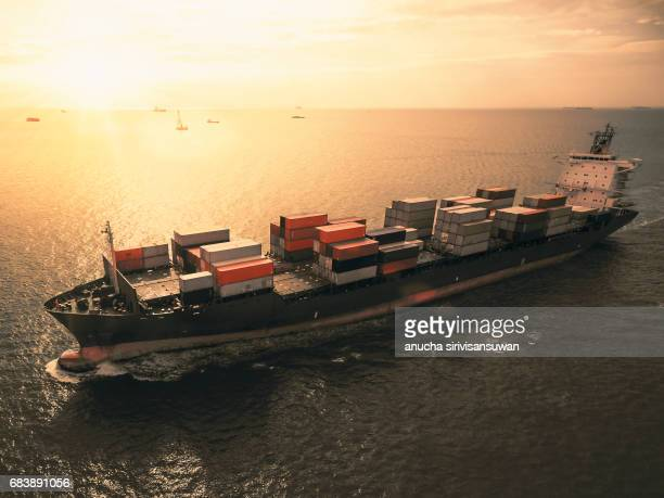 aerial view of cargo ship with containers , top view . - ship front view stock-fotos und bilder