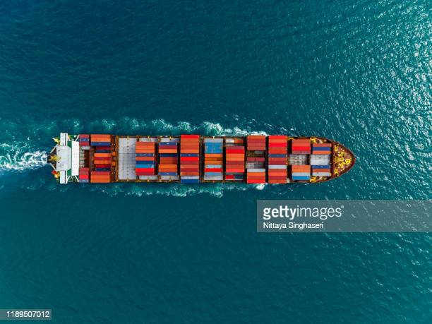 aerial view of cargo ships in containers sailing in the sea. - 貨物船 ストックフォトと画像