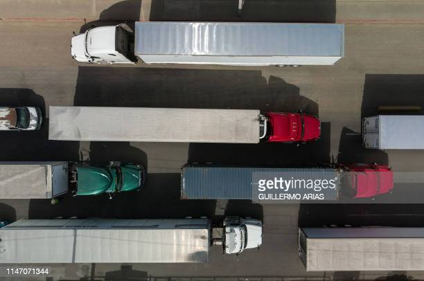 Aerial view of cargo trucks heading to the United States lining up near the commercial port of entry in Otay, in Tijuana, Baja California state on...