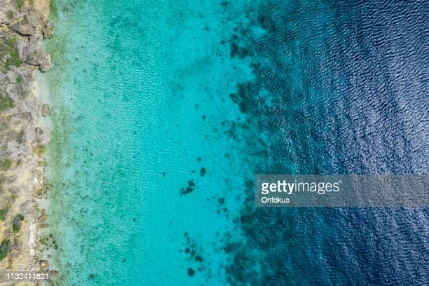 aerial view of caribbean sea in curacao - coral colored stock pictures, royalty-free photos & images