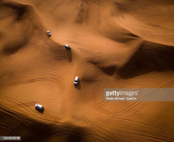 aerial view of cars at desert - desert stock pictures, royalty-free photos & images
