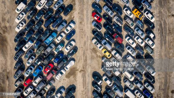 aerial view of cars at parking lot - junkyard stock photos and pictures