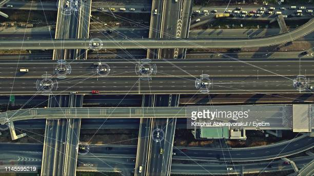 aerial view of cars connecting on elevated road - デジタル合成 ストックフォトと画像