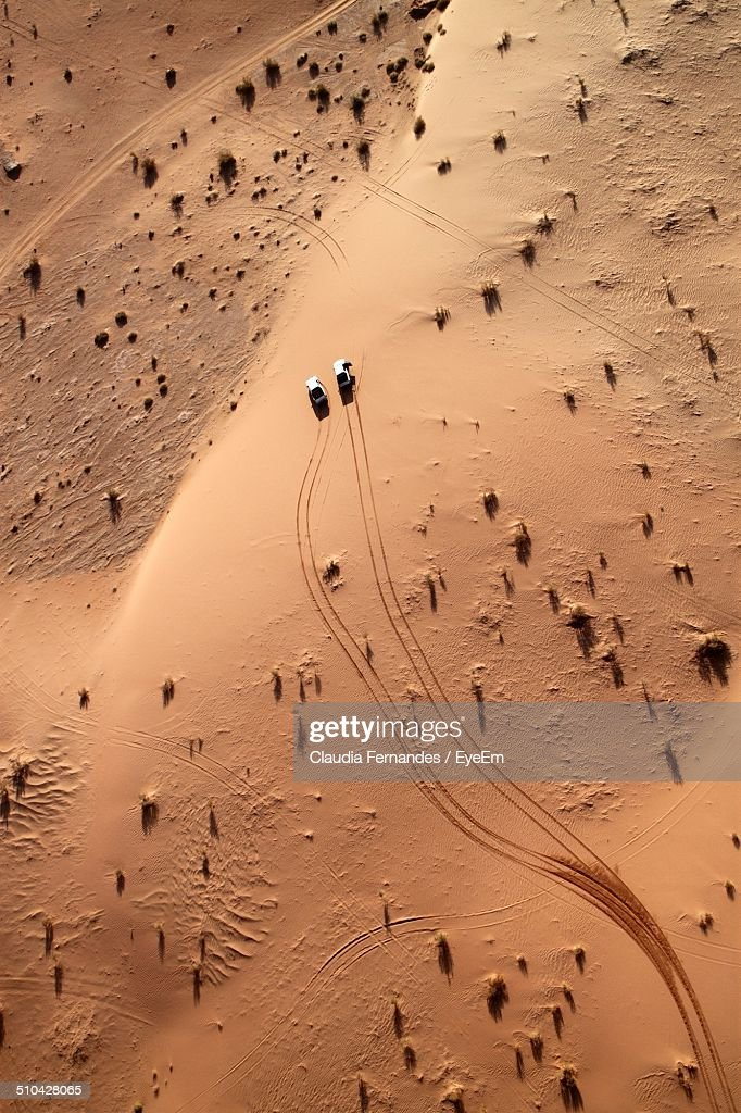 Aerial view of cars driving through desert : Stock Photo