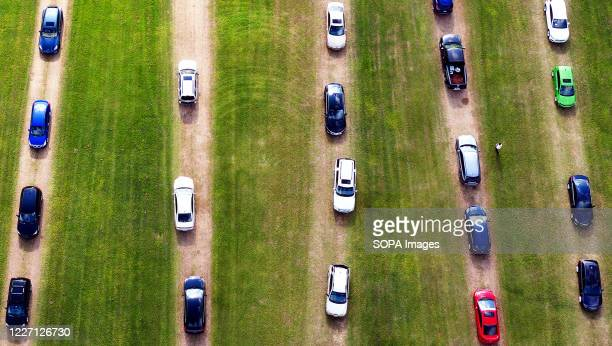 Aerial view of cars forming a queue in a field as hundreds of people arrive to be tested for COVID-19 at a drive through testing site at Osceola...