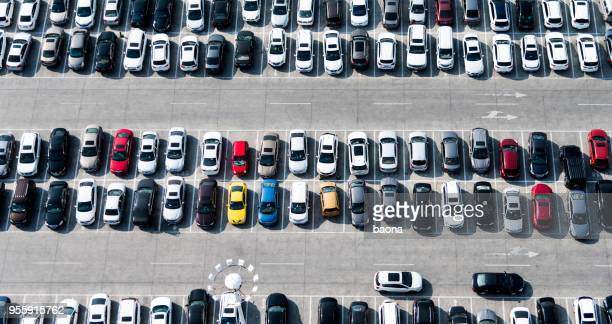 aerial view of cars in a parking lot - full stock pictures, royalty-free photos & images