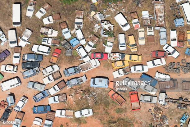 aerial view of cars in junkyard - junkyard stock photos and pictures