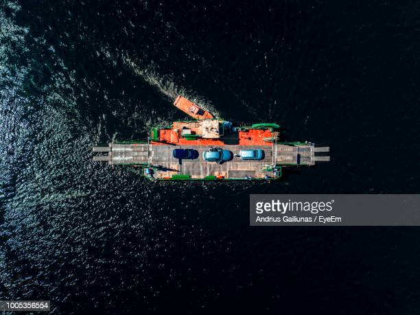 aerial view of cars on boat in sea - ferry stock pictures, royalty-free photos & images