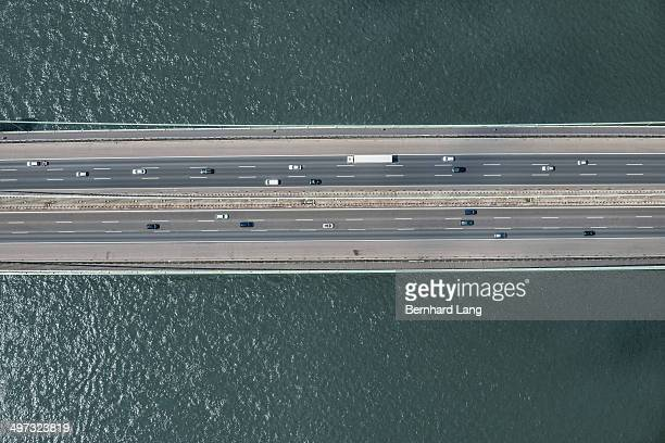 Aerial view of cars on bridge over river