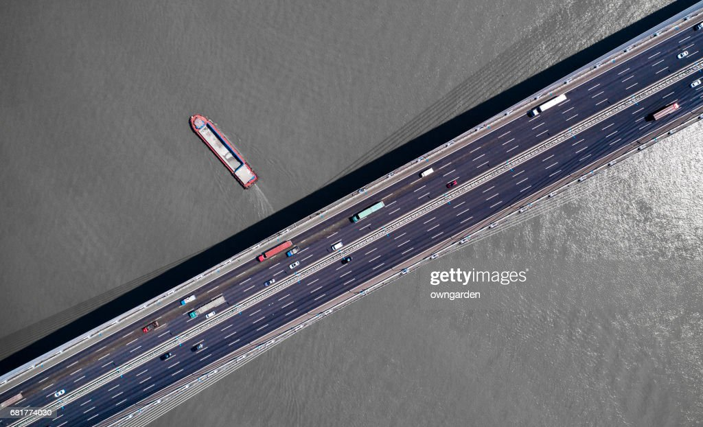 Cars on bridge over huangpu River at shanghai, china.