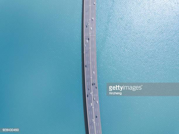 aerial view of cars on bridge over river - standing water stock pictures, royalty-free photos & images