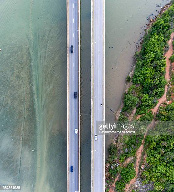 Aerial view of cars on bridge over Songkla Lake, Thailand
