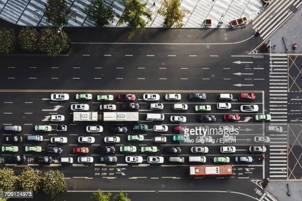 aerial view of cars on street - traffico foto e immagini stock