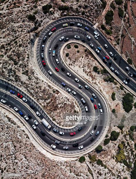 aerial view of cars on winding road shaped as letter s - letter s stock pictures, royalty-free photos & images