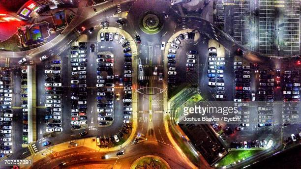 Aerial View Of Cars Parked At Parking Lot During Night