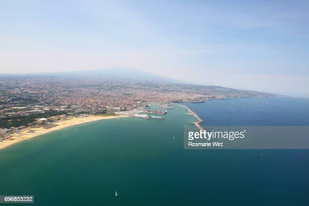 Aerial view of  Catania harbor and town with Mount Etna