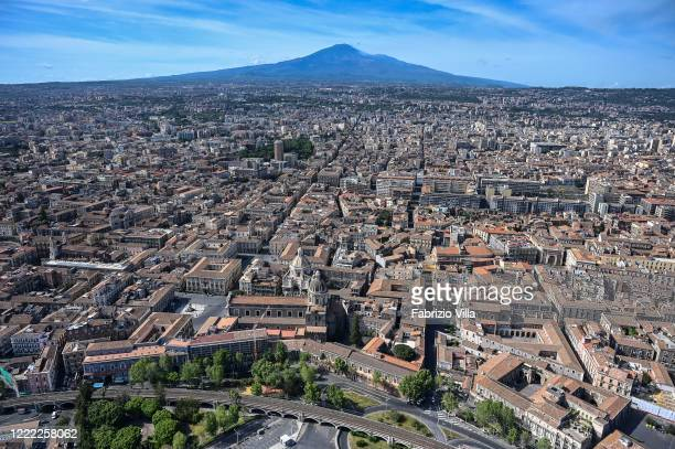 Aerial view of Catania in the background the volcano Etna during an operational mission from the Coast Guard helicopter on May 01 2020 in Catania...