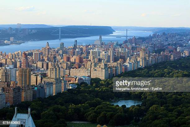 Aerial View Of Central Park And Cityscape By River