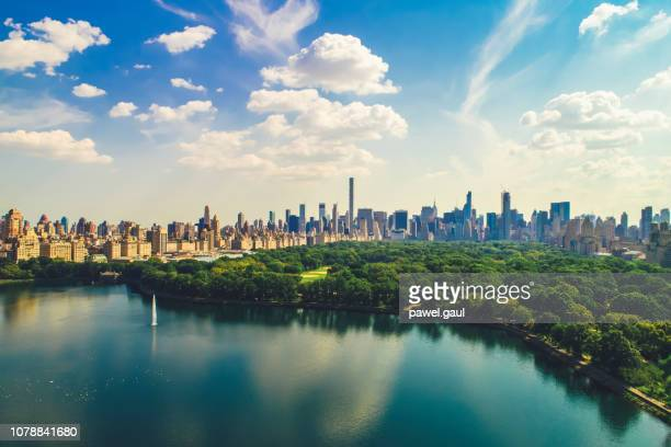 aerial view of central park with manhattan skyline - central park stock photos and pictures
