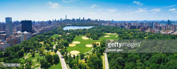 aerial view of central park with manhattan skyline - central park manhattan stock pictures, royalty-free photos & images