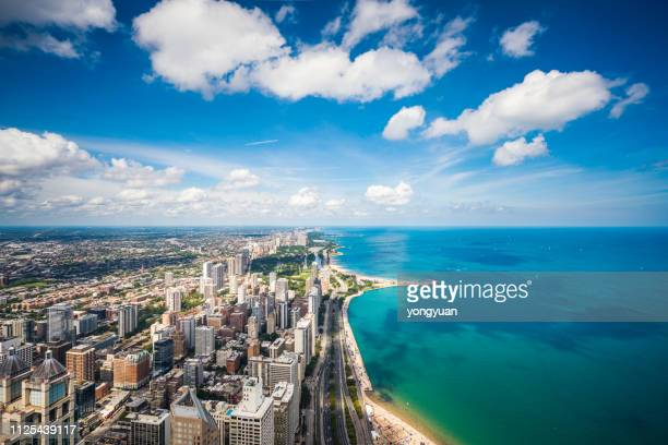 aerial view of chicago cityscape and lake michigan - great lakes stock pictures, royalty-free photos & images