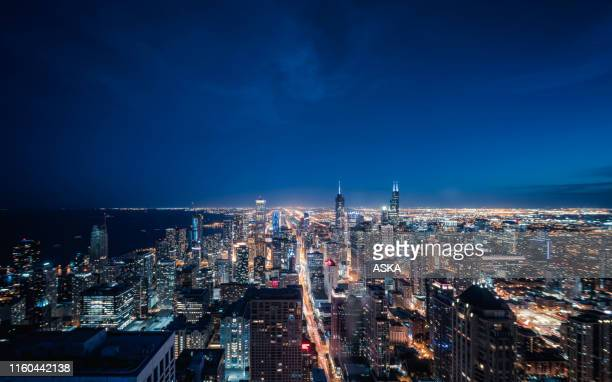 aerial view of chicago cityscape skyline at night - city night stock pictures, royalty-free photos & images