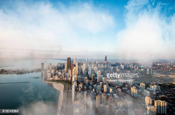 aerial view of chicago waterfront with misty sky - chicago stock-fotos und bilder