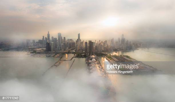 aerial view of chicago with misty sky - moody sky stock pictures, royalty-free photos & images