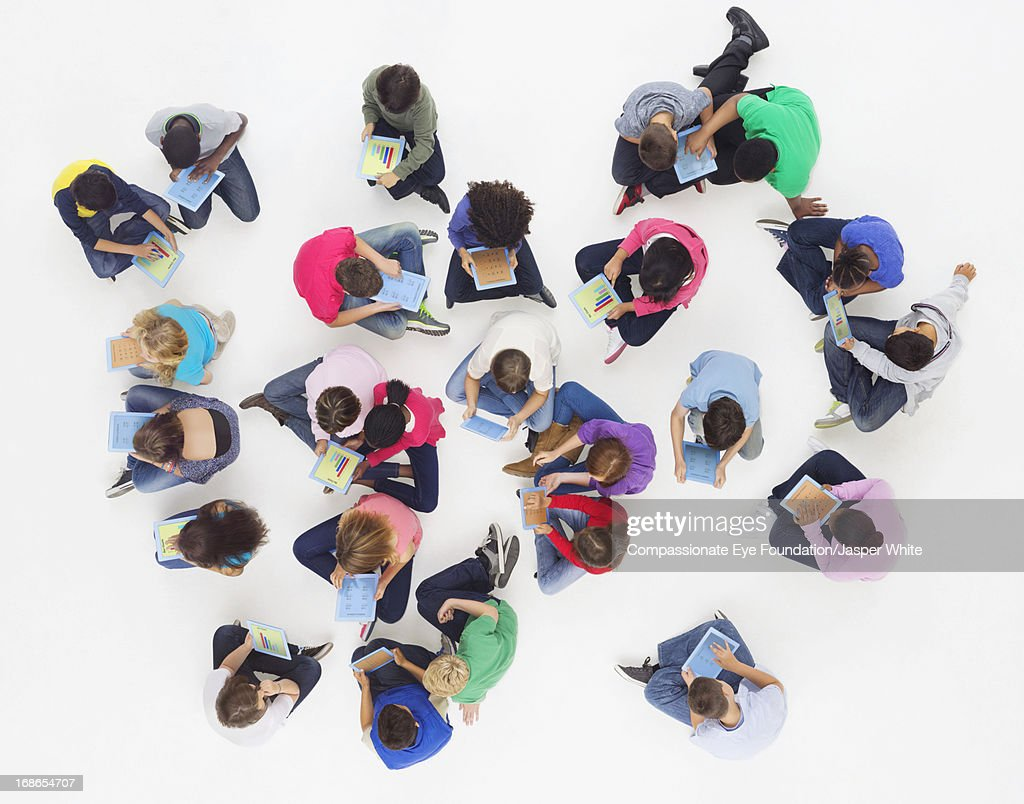Aerial view of children using digital tablets : Stock Photo