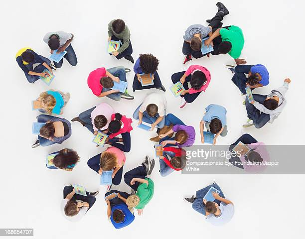 Aerial view of children using digital tablets