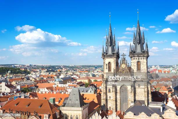 aerial view of church of our lady before tyn at prague old town square opposite prague astronomical clock or prague orloj, famous landmark in old town of prague, czech republic, europe - prag stock-fotos und bilder