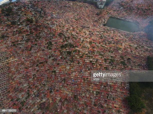 Aerial view of citizens flocking to clean tombs to pay respect to their deceased relatives at Xiaolan Town on April 4 2017 in Zhongshan Guangzhou...
