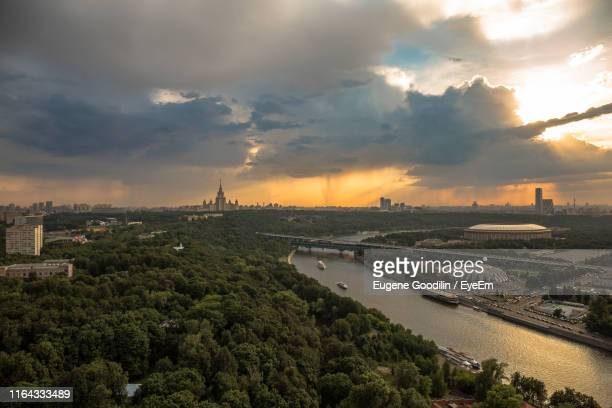 Aerial View Of City Against Cloudy Sky During Sunset
