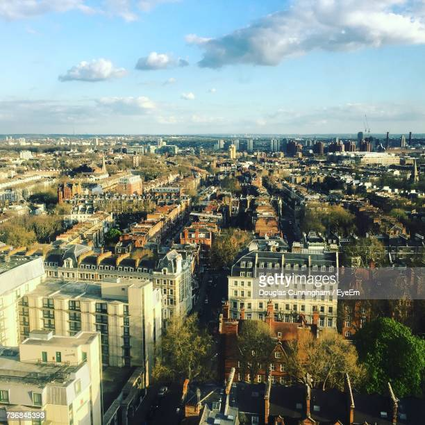 aerial view of city against cloudy sky - kensington and chelsea stock pictures, royalty-free photos & images