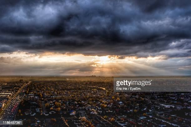 aerial view of city against sky during sunset - mississauga stock pictures, royalty-free photos & images