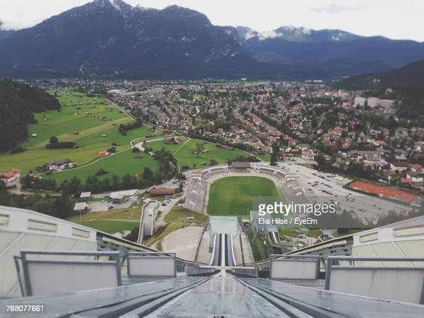 aerial view of city against sky - garmisch partenkirchen stock photos and pictures