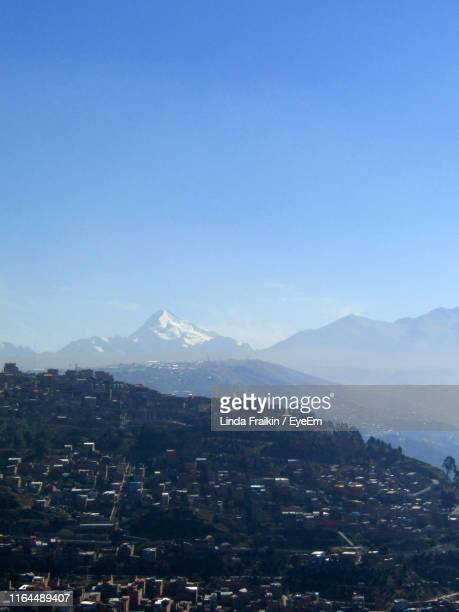 aerial view of city and mountains against clear blue sky - linda fraikin stock pictures, royalty-free photos & images