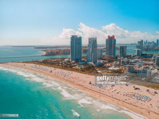 aerial view of city and sea against sky - fisher island stock pictures, royalty-free photos & images