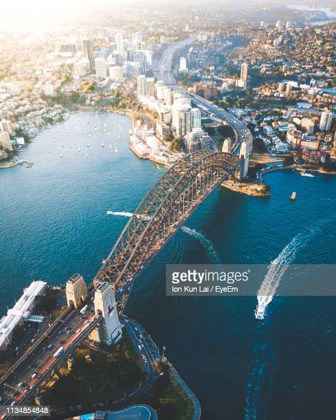 aerial view of city and sea - sydney stock pictures, royalty-free photos & images
