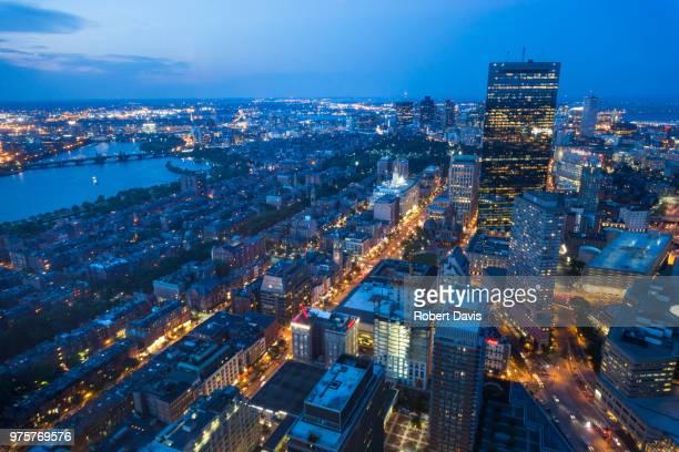 aerial view of city at dusk, boston, massachusetts, usa - massachusetts foto e immagini stock