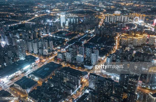 aerial view of city at night - liyao xie stock pictures, royalty-free photos & images