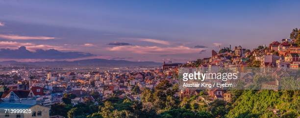 aerial view of city at night - antananarivo stock photos and pictures