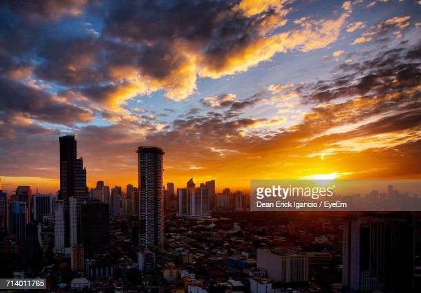 aerial view of city at sunset - makati stock photos and pictures