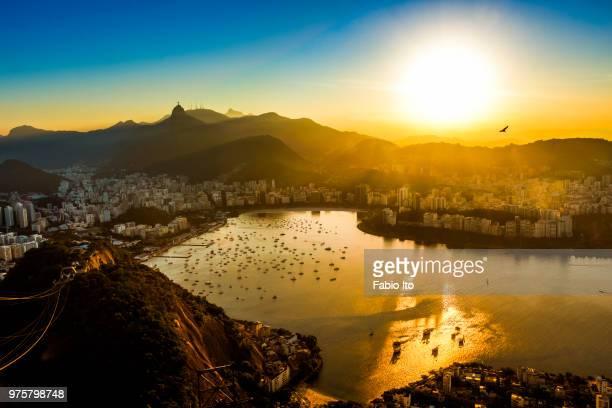 aerial view of city at sunset, rio de janeiro, brazil - rio de janeiro imagens e fotografias de stock