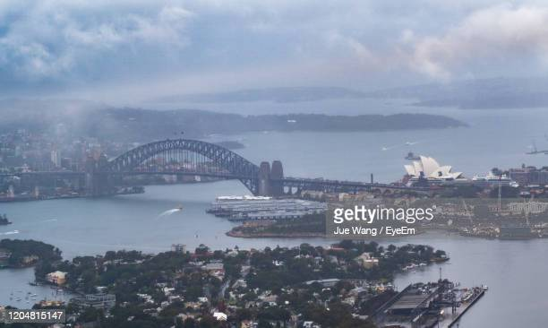 aerial view of city at waterfront - wang he stock pictures, royalty-free photos & images